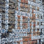 A crossword puzzle painted onto a brick wall / Image: Unsplash