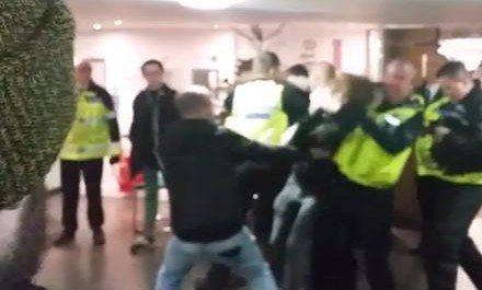 Video appearing to show a policeman with a student in a headlock