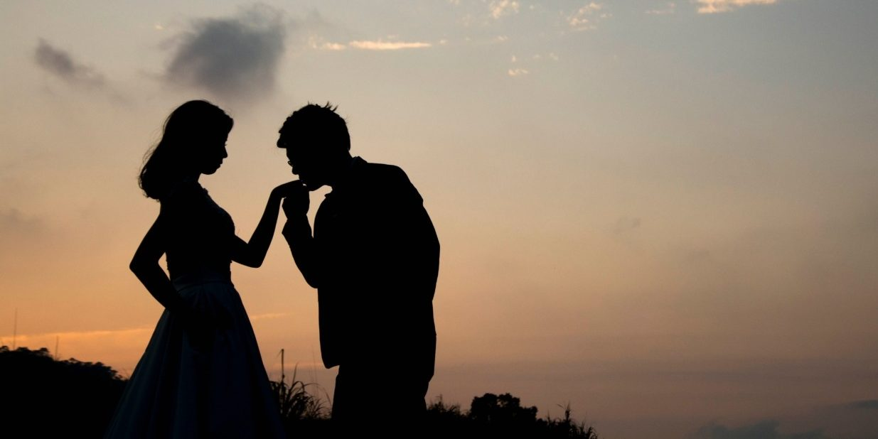 Silhouette of a couple against a sunset.