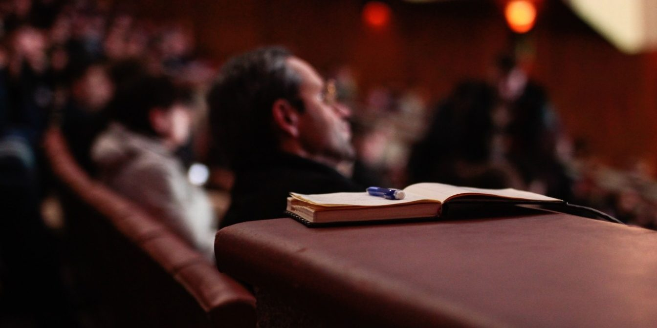 Open notebook in the audience of a theatre