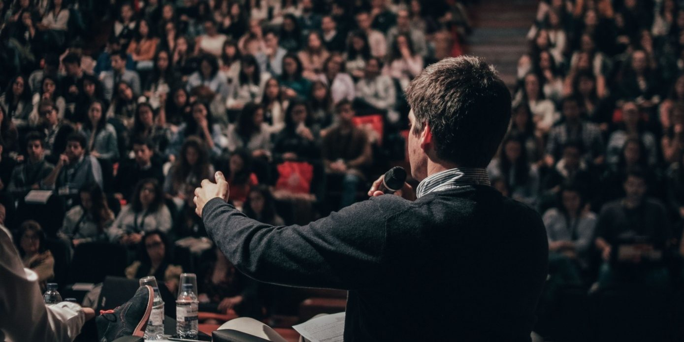 Man speaking in front of crowd