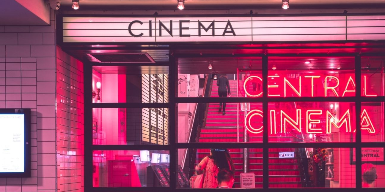 Neon pink cinema entrance