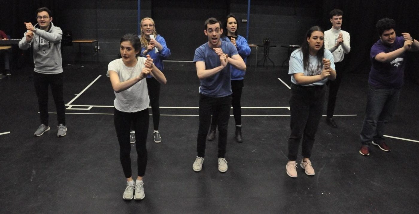 The company of WUDS' 'A Chorus of Disapproval' in rehearsal