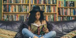Girl in bookshop reading a book love