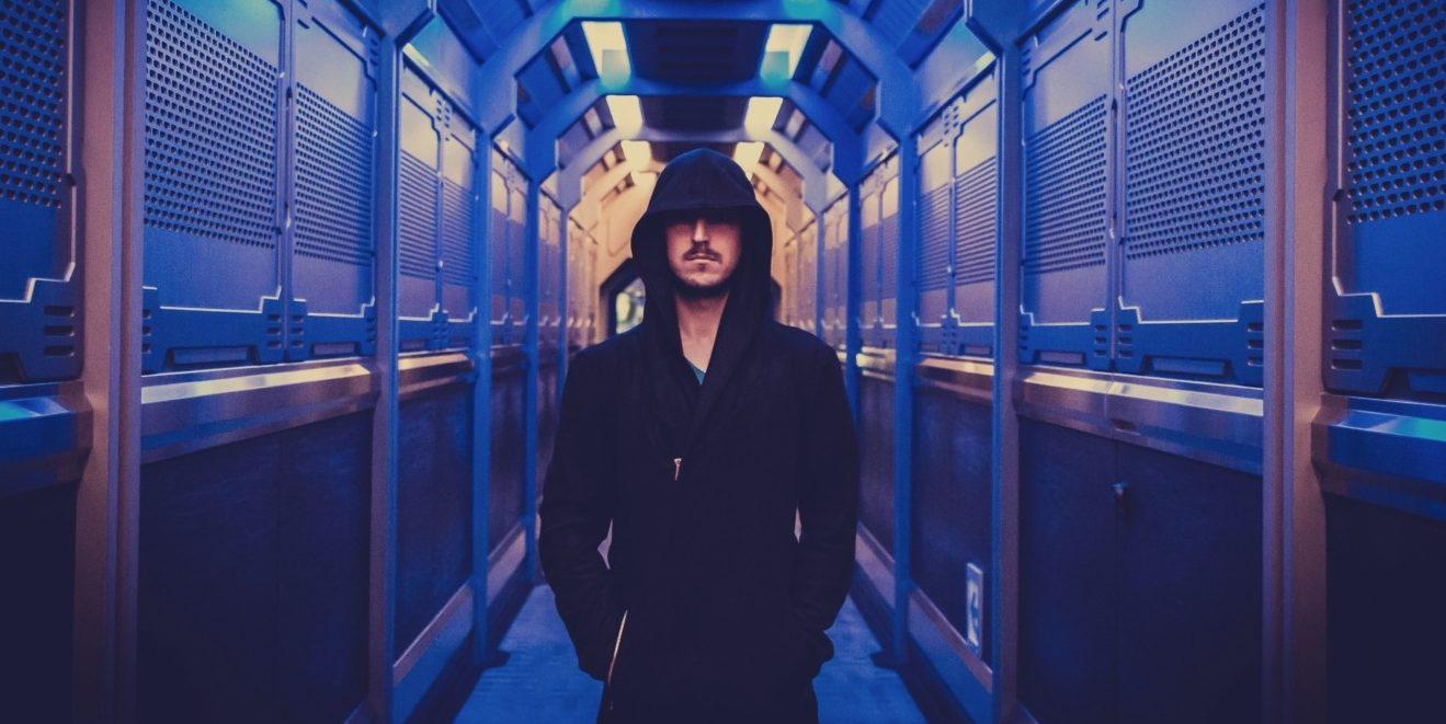 Villain stood in neon alleyway