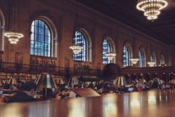 New York public library inside view. People studying.