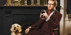 Samuel Dodson sat on a chair with a dog