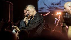 Morrissey on dark lit stage