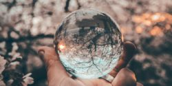 Person holding crystal ball - writers visionaries