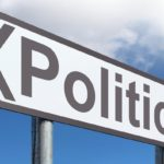 Highway sign with Politics