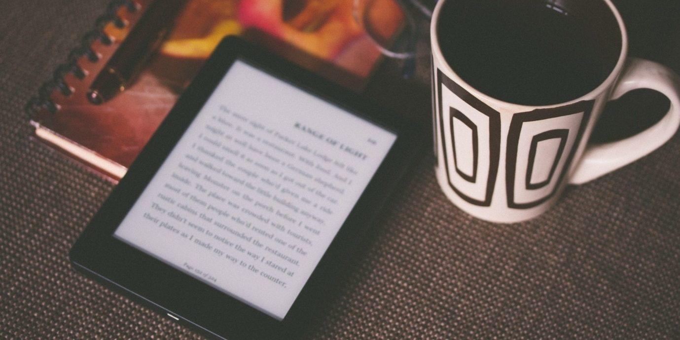 E-book on a table with mug - Salinger