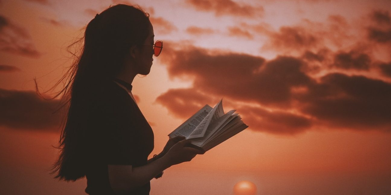 Woman reading book against sunset -#MeToo article