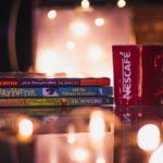 Harry Potter books next to a mug
