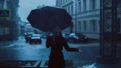 girl standing with umbrella on rainy-day