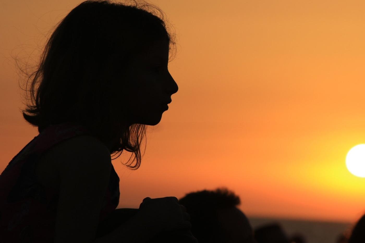 sunset, girl watching Eurovision