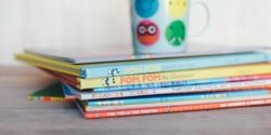 pile of children books for statutory storytime