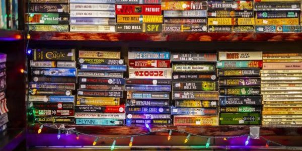 stacked books at a market - booker prize