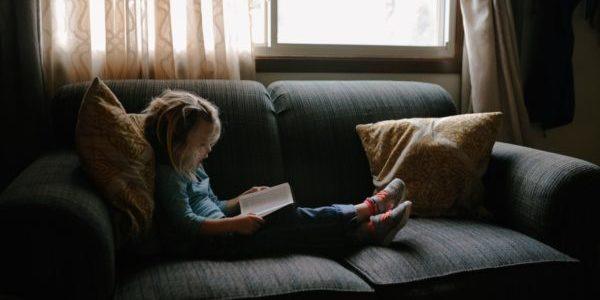 girl reading on sofa - jacqueline