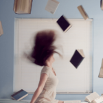 girl with books flying a book
