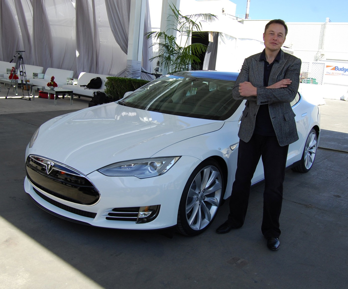 Elon Musk by a car / Image: Wikimedia Commons