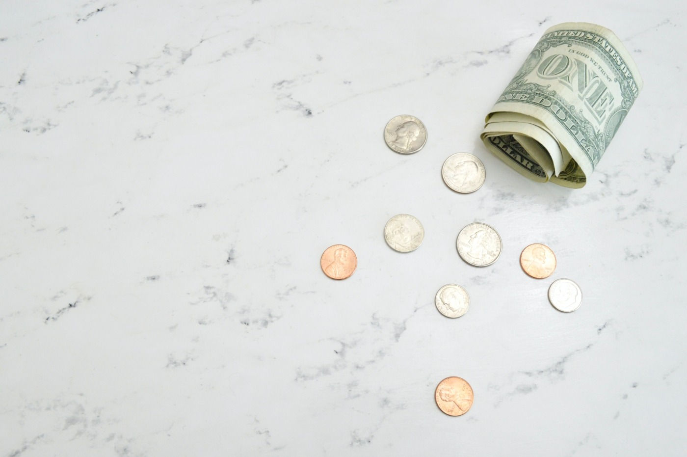 Money on marble / Image: Unsplash