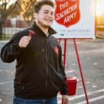 Man by Salvation Army Poster / Image: Unsplash